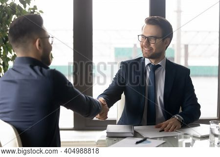 Smiling Hr Manager Shaking Hand Of Successful Candidate After Interview