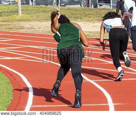 High School Girls Starting A Sprint Running Race On An Outdoor Track Wearing Black Spandex Taken Fro