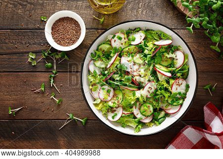 Radish And Cucumber Salad With Fresh Green Onion In Bowl, Top View