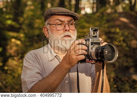 Manual Settings. Pension Hobby. Experienced Photographer. Old Man Shoot Nature. Cameraman Retirement