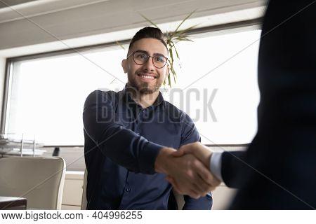 Close Up Smiling Arabian Candidate Shaking Employer Hand, Getting Job