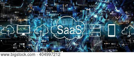 Saas - Software As A Service Concept With Aerial View Of Urban City At Night