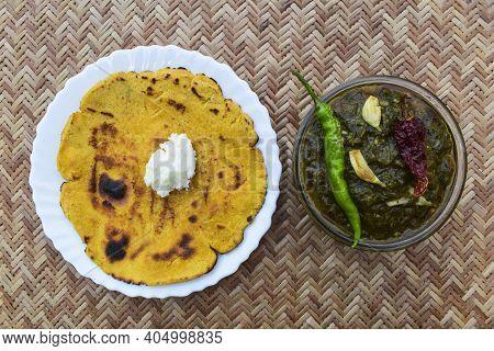 Indian Popular Dish Makki Di Roti And Sarson Da Saag, Mustard Leaves Curry And Unleavened Maize Flou