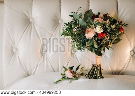 Wedding Bouquet With Roses And Boutonniere.the Decor At The Wedding