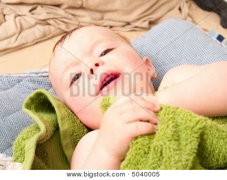 Cute Baby Boy Lying Wrapped In A Towel