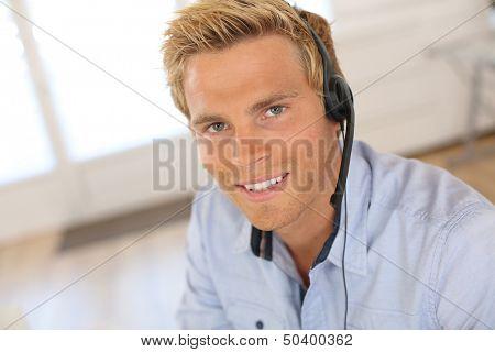Smiling attractive customer service representative poster