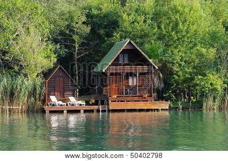 wooden house along the lush Ada Bojana riverside, Montenegro
