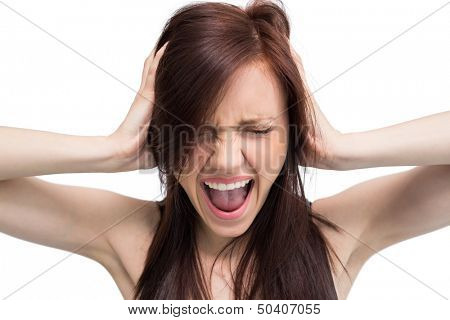 Close up on exasperated brunette on white background screaming