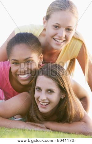 Teenage Girls Having Fun Outdoors