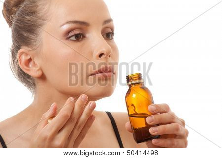 woman smelling bottle, isolated on white background