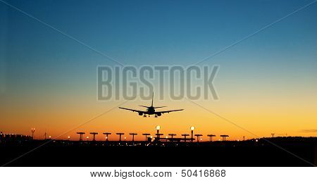 Aircraft Approaching Airport At Sunset