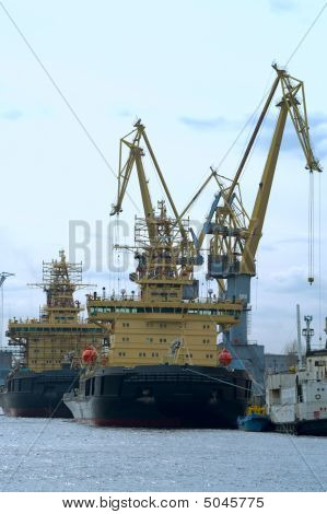 Several Ships Load Cargo On Board By Harbour Cranes