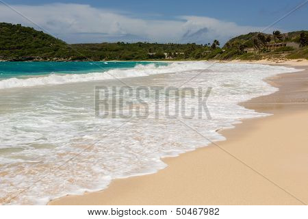 Waves Crashing On Beach At Half Moon Bay Antigua