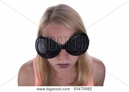 A Young Blond Teen With Huge Sunglasses Sulking Isolated poster