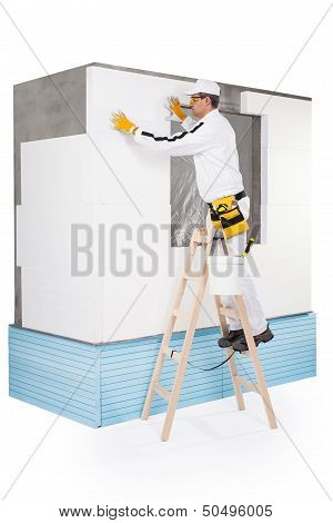 Worker Fixing An Insulation Panel