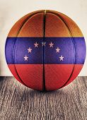 Close up of an old leather basketball with Venezuela flag poster