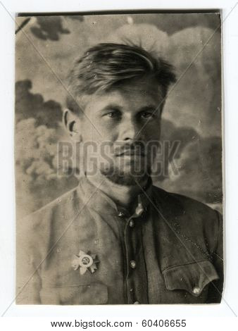 MOSCOW, USSR - CIRCA 1945: An antique photo shows studio portrait of a Red Army officer guerrillas in uniform.