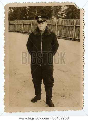 MOSCOW, USSR - CIRCA 1960s: An antique photo shows studio portrait of a Red Army soldiers, a mechanic  in winter uniform.