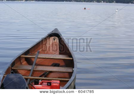 Fishing boat and swimmer