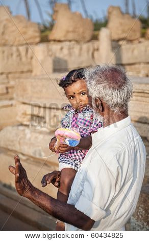 Indian Man With Little Girl In India
