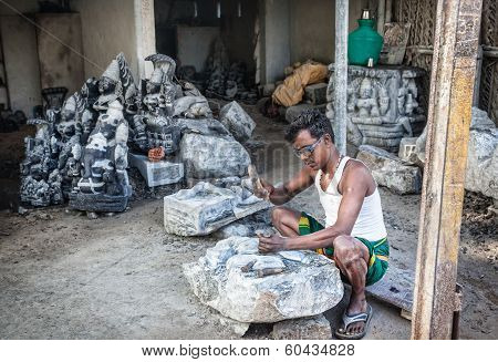 Indian Man Carving Stone Statue