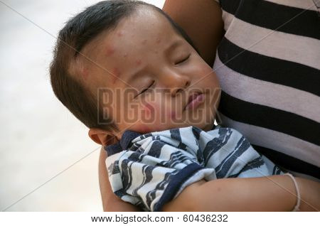 Child in a mother's embrace