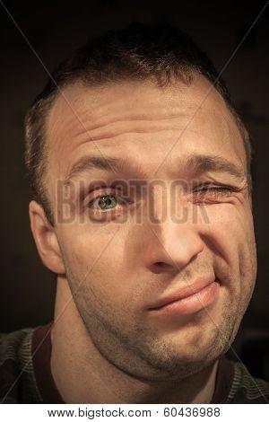 Young Frivolous Caucasian Man Portrait On Dark Background