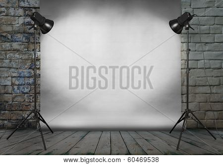 photo studio in old grunge room with brick wall and paper background