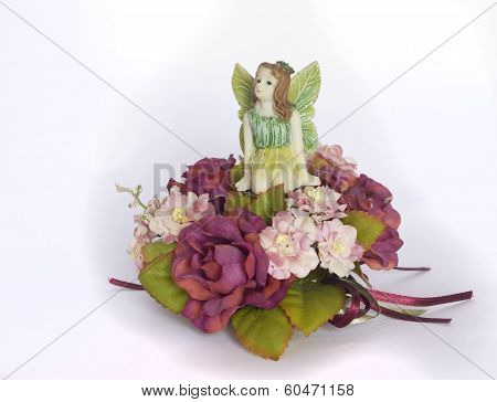 Girl Elf Sitting On A Floral Wreath