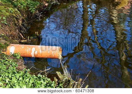 Industrial Pipe Dumping Waste Water Into The river poster