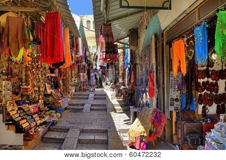 JERUSALEM, ISRAEL - AUGUST 21, 2013: Bazaar in Old City offers middle east traditional products and souvenirs. It is very popular site with tourists and pilgrims visiting Jerusalem, Israel.