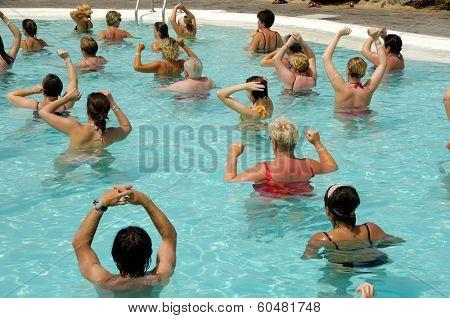 People doing water aerobic in pool