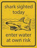 Grunge shark attack warning sign vector eps 8 poster