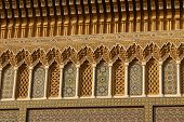 Detail of the beautiful tile mosaic decoration of the at Fez Morocco poster