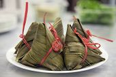 Glutinous Rice Dumpling Wrapped in Bamboo or Large Flat Leaves Closeup poster
