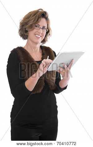 Mature Attractive Businesswoman Writing On Her Tablet Computer. Isolated Over White Background.