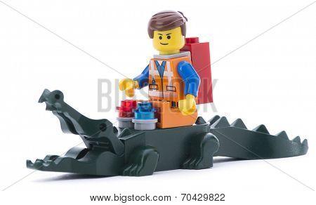 Ankara, Turkey - March 15, 2014 : Lego movie minifigure character Emmet riding alligator isolated on white background.