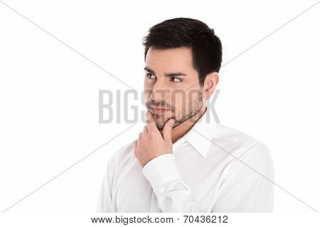 Serious And Pensive Isolated Young Businessman Looking Sideways.