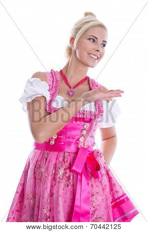 Bavarian woman - isolated in bavarian pink garb presenting and making promotion. poster