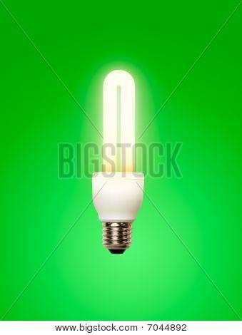 Energy saving lamp green background