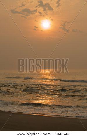 Ocean sunset reflection.
