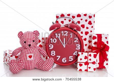 Christmas: Red And White Presents With Clock And  Pink Teddy Bear On White Background - Last Minute