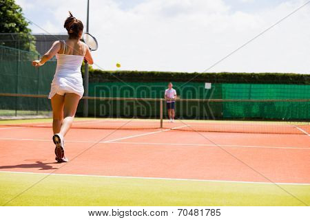 Tennis match in progress on the court on a sunny day poster