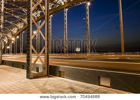 Bolsheokhtinsky bridge across the Neva River in St. Petersburg in the evening illumination poster