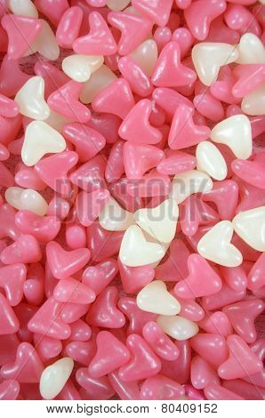 Pink And White Heart Shape Jelly Candy Confectionary Background - Vertical Closeup.