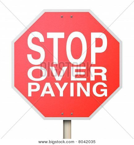 A red octogon shaped sign with the words Stop Over Paying poster