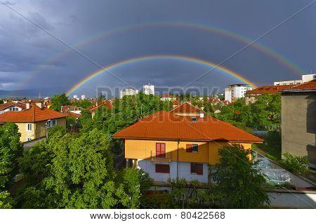 Double rainbow over the city