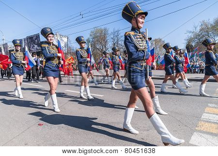 Girls in hussar form march with tags