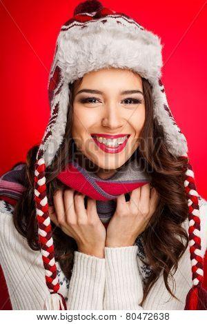 Studio portrait of woman in winter hat.