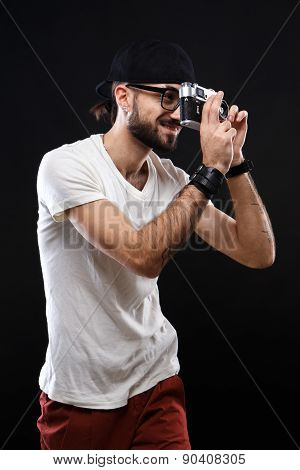 Charismatic guy in a white shirt and glasses with camer